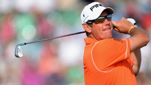 Westwood leads Woods, Mahan after 54 holes