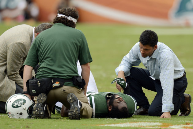 FILE - In this Sunday, Sept. 23, 2012 file photo, New York Jets trainers attend to cornerback Darrelle Revis (24) during the second half of an NFL football game against the Miami Dolphins, in Miami. Revis has a torn anterior cruciate ligament in his left knee that will require surgery, likely meaning he'll miss the rest of the season, the team announced Monday, Sept. 24. (AP Photo/Rhona Wise, File)