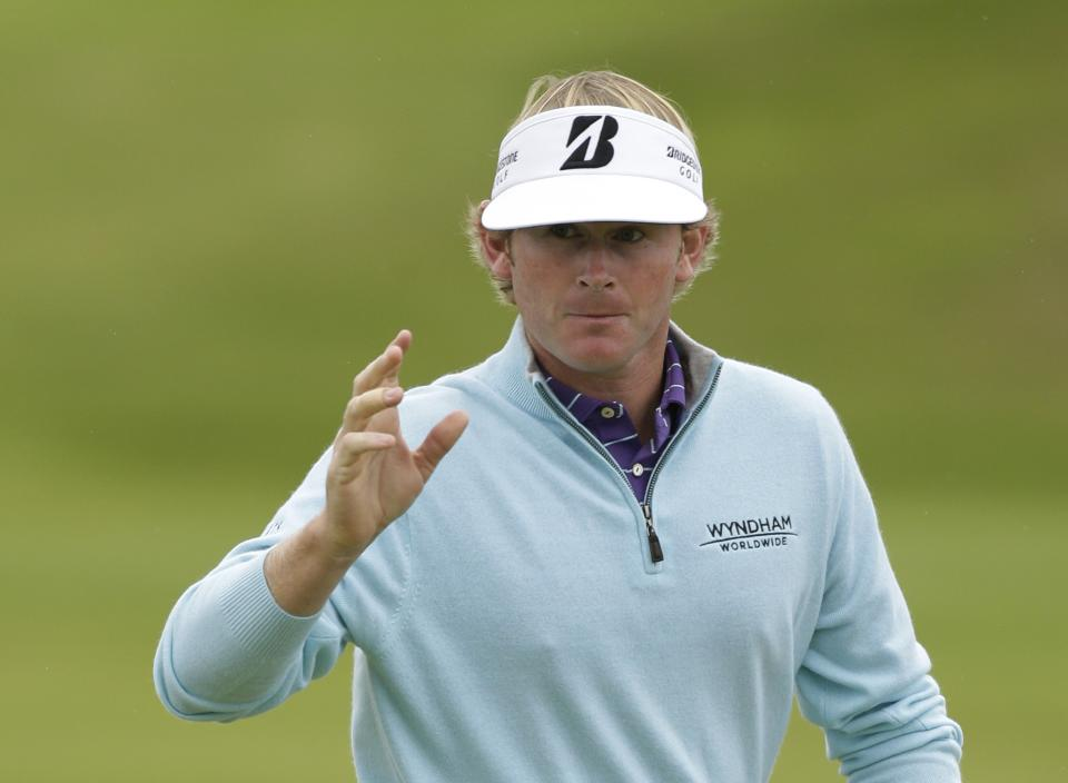 Brandt Snedeker of the United States gestures after finishing his second round at Royal Lytham & St Annes golf club of the British Open Golf Championship, Lytham St Annes, England, Friday, July 20, 2012. (AP Photo/Peter Morrison)