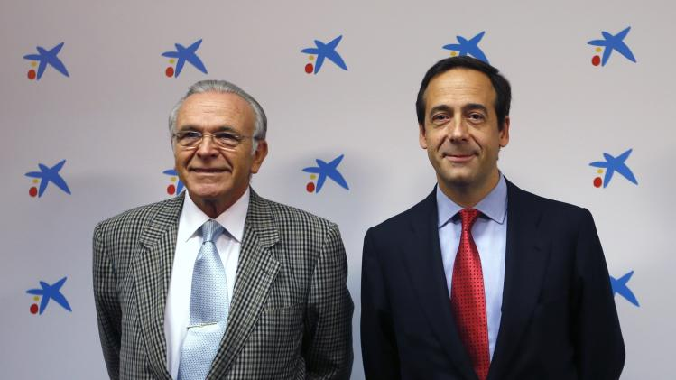 Caixabank President Faine and Chief Executive Gortazar pose before reporting second-quarter results at La Caixa headquarters in Barcelona