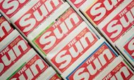 Sun Reporter Charged With Corruption