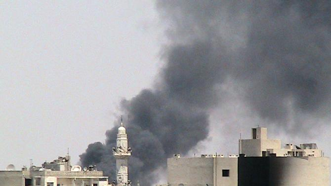 This citizen journalism image provided by Shaam News Network SNN, taken on Friday, Aug. 3, 2012, purports to show pillars of smoke as a result of shelling by Syrian government forces near al-Zafaran mosque in Homs, Syria. (AP Photo/Shaam News Network, SNN) THE ASSOCIATED PRESS IS UNABLE TO INDEPENDENTLY VERIFY THE AUTHENTICITY, CONTENT, LOCATION OR DATE OF THIS CITIZEN JOURNALIST IMAGE