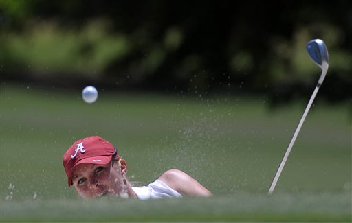 Alabama's Jennifer Kirby blasts from the No. 4 bunker during the NCAA Division 1 Women's Golf Championships played at the University of Georgia Golf Course, Friday, May 24, 2013, in Athens, Ga