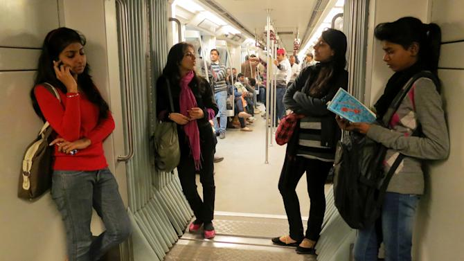 Indian women travel inside a Women Only metro train compartment in New Delhi, India, Saturday, Feb. 2, 2013. Five men pleaded not guilty after being formally indicted Saturday in a special court on 13 charges, including rape and murder, in the fatal gang rape of a woman in a New Delhi bus, a lawyer said. The brutal attack set off nationwide protests, sparking a debate about the treatment of women in India and highlighting the inability of law enforcement agencies to protect them. (AP Photo/Yirmiyan Arthur)