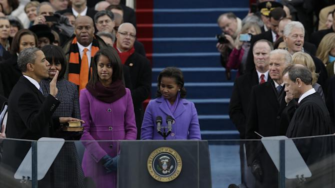 President Barack Obama is sworn by Chief Justice John Roberts at the ceremonial swearing-in at the U.S. Capitol during the 57th Presidential Inauguration in Washington, Monday, Jan. 21, 2013. (AP Photo/Pablo Martinez Monsivais)