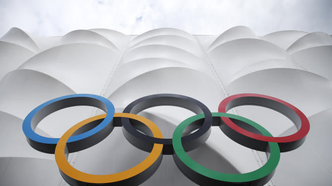 The Olympic rings are displayed outside the basketball arena in the Olympic Park before the start of  the 2012 Summer Olympics, Sunday, July 15, 2012, in London. (AP Photo/Jae Hong)