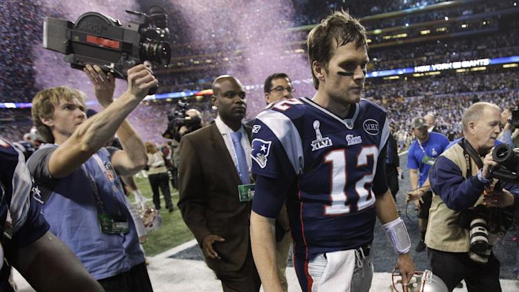 Feb. 5 New England Patriots quarterback Tom Brady walks off the field after the Patriots' 21-17 loss to the New York Giants in the NFL Super Bowl XLVI football game, Sunday, Feb. 5, 2012, in Indianapolis. (AP Photo/Paul Sancya)