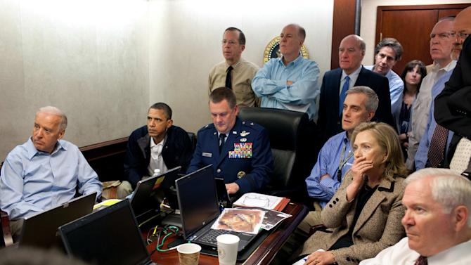 FILE - In this May 1, 2011 file image released by the White House and digitally altered by the source to obscure the details of a document in front of Secretary of State Hillary Rodham Clinton, President Barack Obama and Vice President Joe Biden, along with with members of the national security team, receive an update on the mission against Osama bin Laden in the Situation Room of the White House in Washington.     Hidden from view, standing just outside the frame of this photograph was a career CIA analyst whose job for nearly a decade was finding the al-Qaida leader.   (AP Photo/The White House, Pete Souza/file)
