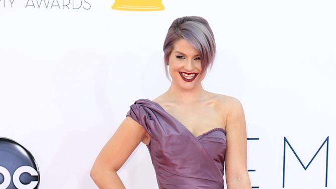 Kelly Osbourne arrives at the 64th Primetime Emmy Awards at the Nokia Theatre on Sunday, Sept. 23, 2012, in Los Angeles. (Photo by Matt Sayles/Invision/AP)