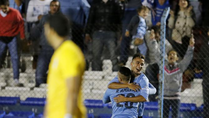Uruguay's Franco Acosta celebrates with teammate Rodrigo Amaral after scoring against Peru during their match for the final round of the South American Under-20 Championship in Montevideo