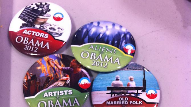 """Obama campaign buttons micro-target nuns, space aliens, cat lovers and """"old married folk"""" at a stand in the arena at the Democratic National Convention on Wednesday, Sept. 5, 2012. (Jennie Josephson/Yahoo! News)"""
