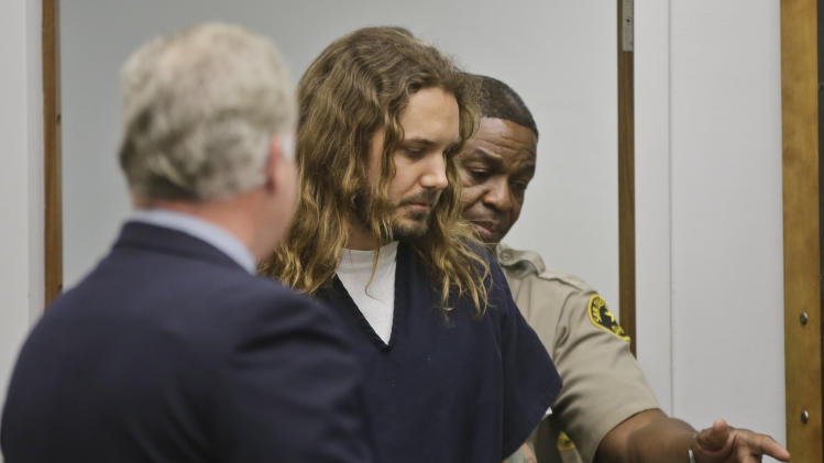 Metal singer charged with soliciting wife's murder