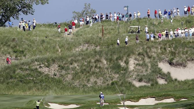 A golfer chips to the seventh green during the first round of the Senior PGA Championship golf tournament at the Harbor Shores Golf Club in Benton Harbor, Mich., Thursday, May 24, 2012. (AP Photo/Carlos Osorio)