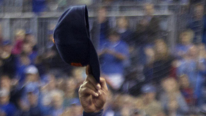 Detroit Tigers' Miguel Cabrera (24) waves to the crowd after being replaced during the fourth inning of a baseball game against the Kansas City Royals at Kauffman Stadium in Kansas City, Mo., Wednesday, Oct. 3, 2012. (AP Photo/Orlin Wagner)