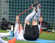 German midfielder Bastian Schweinsteiger warms up during a training session near the Dwor Oliwski hotel in Gdansk. Schweinsteiger admits he has injury worries ahead of Thursday's Euro 2012 semi-final against Italy as he looks to shake off an ankle problem