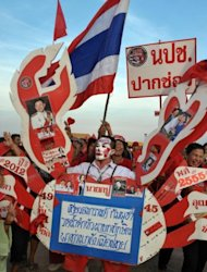 &quot;Red Shirt&quot; supporters of Thailand&#39;s fugitive former premier Thaksin Shinawatra at a rally in Siem Reap province on Saturday. Thaksin told the rally: &quot;There are signs that I will be able to return home to stay with you.&quot;
