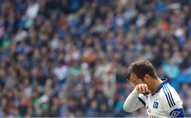 Hamburg's Dutch player  Rafael van der Vaart leaves the pitch after the German Bundesliga soccer match between SV Hamburg and SV Werder Bremen in Hamburg, Germany Saturday Sept. 21, 2013