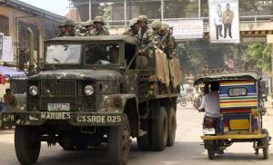 Soldiers ride in a truck as they patrol a road in Jolo, Sulu