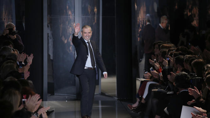 Lebanese fashion designer Elie Saab waves after his Spring Summer 2013 Haute Couture fashion collection, presented in Paris, Wednesday, Jan.23, 2013. (AP Photo/Christophe Ena)