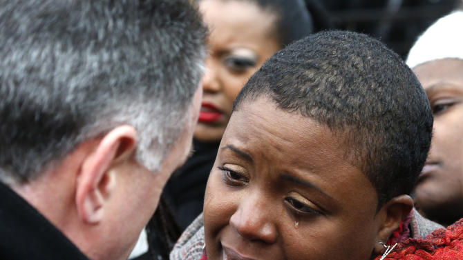 Cleopatra Pendleton cries as she talks with Chicago Police Superintendent Garry McCarthy before a news conference seeking help from the public in solving the murder of Pendleton's daughter Hadiya Wednesday, Jan. 30, 2013, in Chicago. Hadiya, 15, who had performed in President Barack Obama's inauguration festivities, was killed in a Chicago park as she talked with friends by a gunman who apparently was not even aiming at her. The city's 42nd slaying is part of Chicago's bloodiest January in more than a decade, following on the heels of 2012, which ended with more than 500 homicides for the first time since 2008. It also comes at a time when Obama, spurred by the Connecticut elementary school massacre in December, is actively pushing for tougher gun laws. (AP Photo/Charles Rex Arbogast)