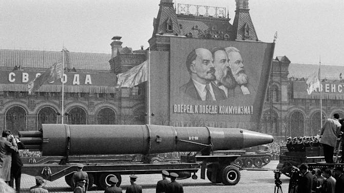 """FILE - In this May 1, 1963 file photo, a Naval rocket is exhibited in Moscow's Red Square past a banner of Vladimir Lenin, Friedrich Engels and Karl Marx during the annual May Day parade in the Soviet Union. Under the shadow of the Cold War's threat of """"mutually assured destruction,"""" 1963 was the year of dawning arms control between the U.S. and the Soviet Union; they signed a Nuclear Test Ban Treaty. (AP Photo/File)"""