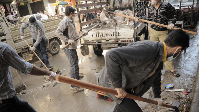In this Saturday, Nov. 10, 2012 photo, activists collect garbage from the streets of Aleppo, Syria. Three months after Free Syrian Army fighters brought the war to Aleppo, street cleaning and garbage pickup services collapsed because of fighting and shelling. (AP Photo/Mónica G. Prieto)