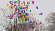 Balloons are released outside the courthouse in Leduc, Alta. in memory of children who have died in government care.