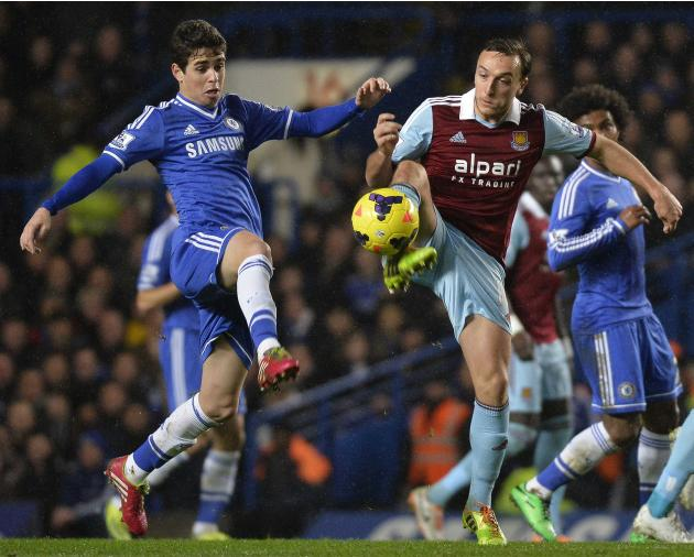 Chelsea's Oscar challenges West Ham United's Noble during their English Premier League soccer match at Stamford Bridge in London