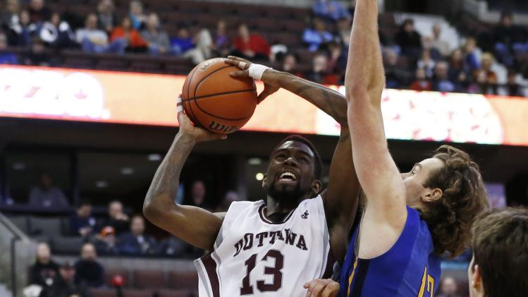 University of Ottawa Gee-Gees' Thomas goes to the basket against University of Victoria Vikes' McLaughlin during their CIS semi-final basketball game in Ottawa
