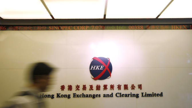 A man walks in the Hong Kong Exchanges and Clearing Ltd. headquarters in Hong Kong Friday, June 15, 2012. Hong Kong's stock exchange operator said Friday it has agreed to buy the 135-year-old London Metal Exchange for 1.4 billion pounds (US$2.2 billion) as it shifts into commodities to capitalize on Chinese demand. (AP Photo/Kin Cheung)