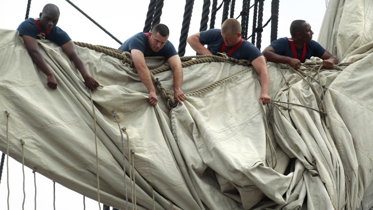 U.S. Navy personnel gather sails in the rigging of the USS Constitution as the vessel arrives at her berth in Charlestown Navy Yard, in Boston, Sunday, Aug. 19, 2012. The U.S. Navy's oldest commissioned war ship sailed under her own power Sunday for the first time since 1997. The sail was held to commemorate the 200th anniversary of the ship's victory over HMS Guerriere in the War of 1812. (AP Photo/Steven Senne)