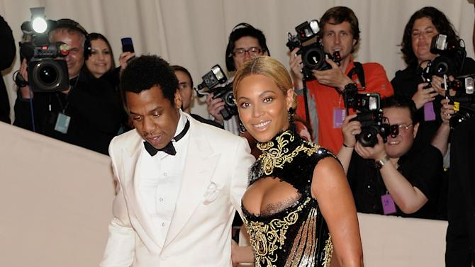 FILE - In a May 2, 2011 file photo, Beyonce Knowles and her husband Jay-Z arrive at the Metropolitan Museum of Art Costume Institute gala in New York. Beyonce will battle her husband for video of the year at the BET Awards, and now both performers are confirmed to attend, The Associated Press reports Friday, June 29, 2012. Beyonce is the second most nominated act. She's up for six awards. Jay-Z is nominated for five. (AP Photo/Evan Agostini, File)