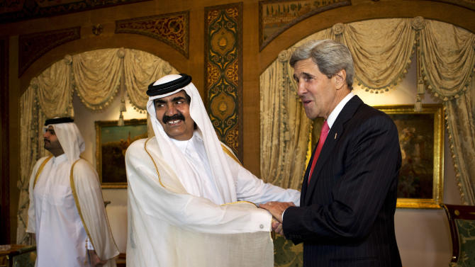 U.S. Secretary of State John Kerry, right, is greeted by Qatari Emir Hamad bin Khalifa Al Thani at Wajbah Palace in Doha, Qatar, on Sunday, June 23, 2013. In Qatar Kerry spent time discussing Syria and Afghanistan. The meeting is the last event in Qatar before Kerry heads to India. (AP Photo/Jacquelyn Martin, Pool)