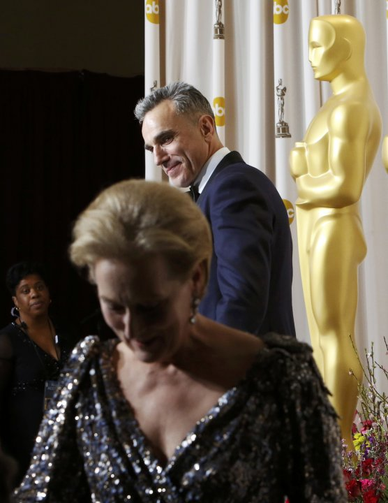 "Day-Lewis, who won the Best Actor Oscar for his role in ""Lincoln"", watches as presenter Streep steps away, backstage at the 85th Academy Awards in Hollywood"