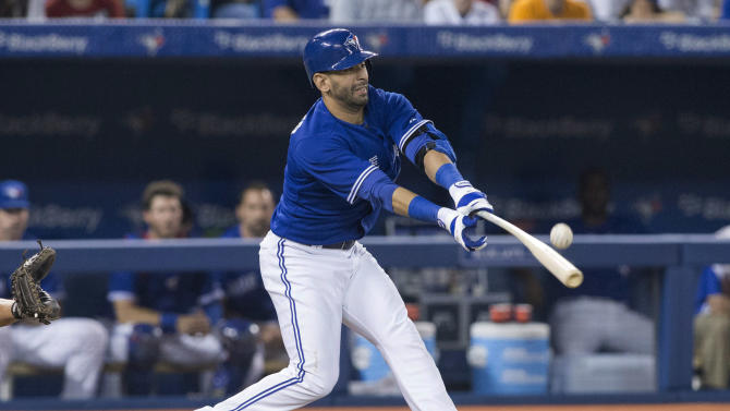 Toronto Blue Jays' Jose Bautista hits a foul ball off Baltimore Orioles pitcher Darren O'Day during the eighth inning of a baseball game in Toronto, Saturday June 22, 2013. (AP Photo/the Canadian Press, Chris Young)