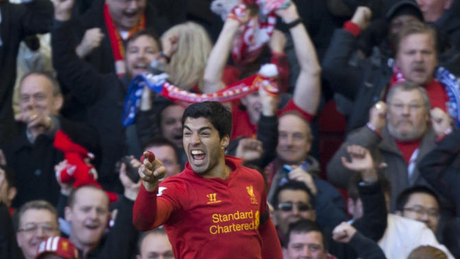 Liverpool's Luis Suarez celebrates after scoring against Chelsea during their English Premier League soccer match at Anfield Stadium, Liverpool, England, Sunday April 21, 2013. (AP Photo/Jon Super)