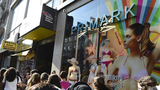 Shoppers pass a Primark clothing shop in central London