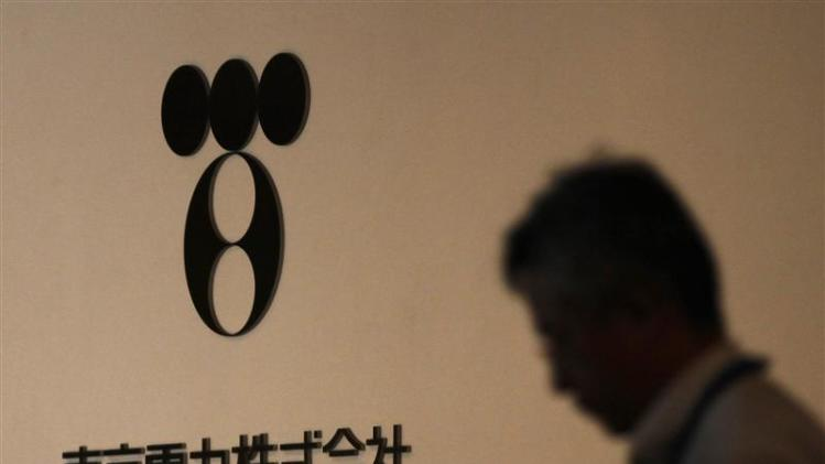 File photo of a man walking past Tokyo Electric Power Co's logo at the company headquarters in Tokyo