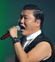 "South Korean singer Park Jae-sang, also known as Psy, performs during his concert at Seoul on October 2, 2012. The 34-year-old singer shot to international fame when his ""Gangnam Style"" video went viral shortly after being posted on YouTube in mid-July"