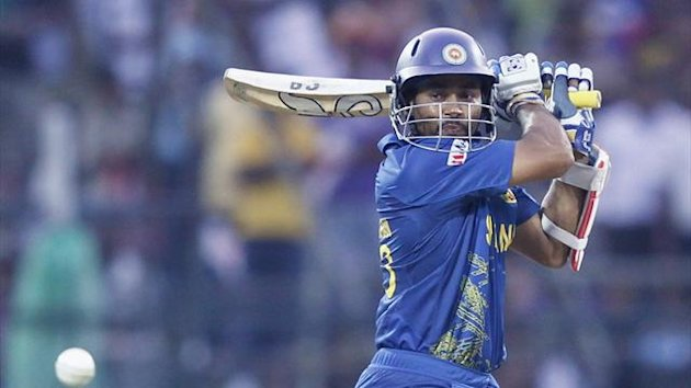 Sri Lanka's Tillakaratne Dilshan plays a shot during their Twenty20 World Cup cricket match against New Zealand in Pallekele September 27, 2012.