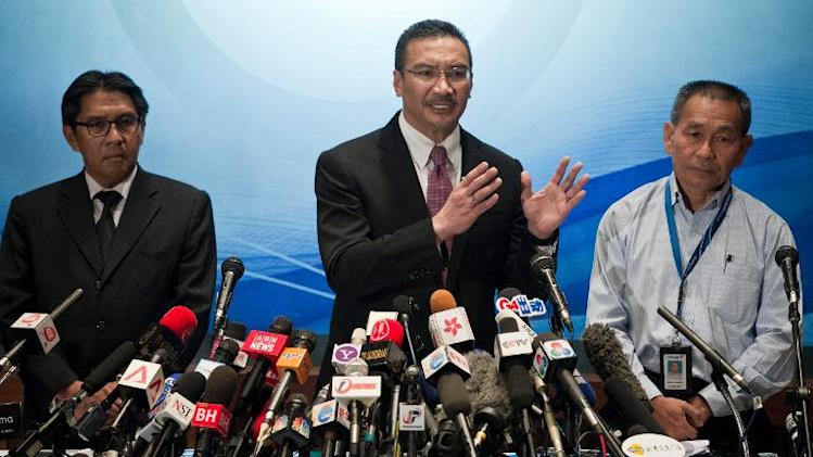 Malaysia's Acting Transport Minister Hishammuddin Hussein (C) answers questions from journalists during a press conference at a hotel near Kuala Lumpur International Airport in Sepang on March 13, 2014