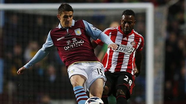 Aston Villa's Ashley Westwood (L) is challenged by Sunderland's Stephane Sessegnon (PA)