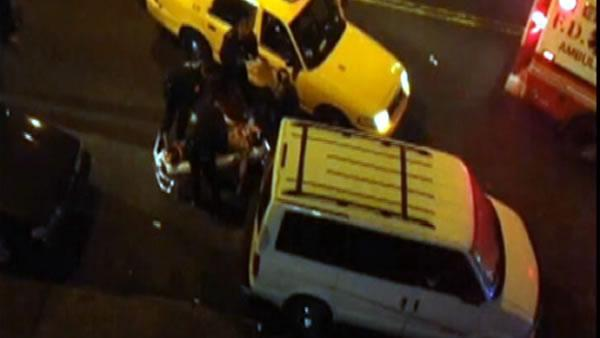 New York City cops lift taxi off man