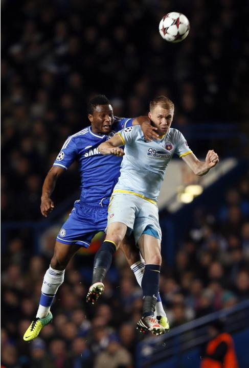 Chelsea's Mikel challenges Steaua Bucharest's Kapetanos during their Champions League soccer match at Stamford Bridge in London