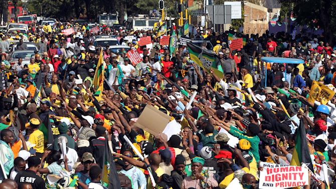 South African ruling party supporters sing during a protest in Johannesburg, South Africa on Tuesday May 29, 2012. The African National Congress and its alliance partners marched to the Goodman Gallery to protest against a now-defaced painting depicting President Jacob Zuma. (AP Photo/Themba Hadebe)