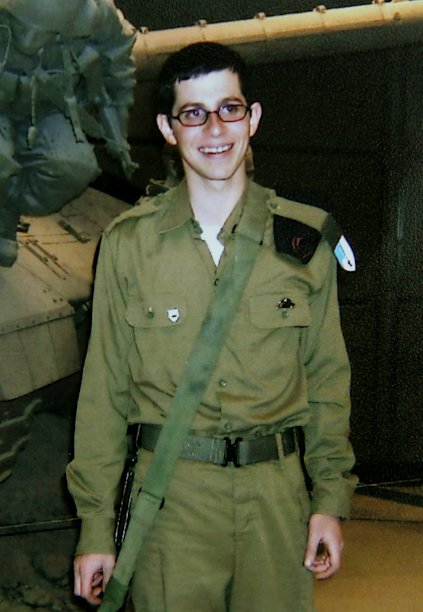 CORRECTS DETAIL - FILE - **  FILE **This undated handout photo released by the Schalit family shows Cpl. Gilad Schalit, who was captured by militants in Gaza during a cross-border raid on June 25, 2006 at the age of 19.   Israeli and Hamas officials announced late Tuesday, Oct. 11, 2011 that they have reached a prisoner swap deal to free Schalit, capping five years of painful negotiations that have repeatedly collapsed. (AP Photo, File)  NO SALES