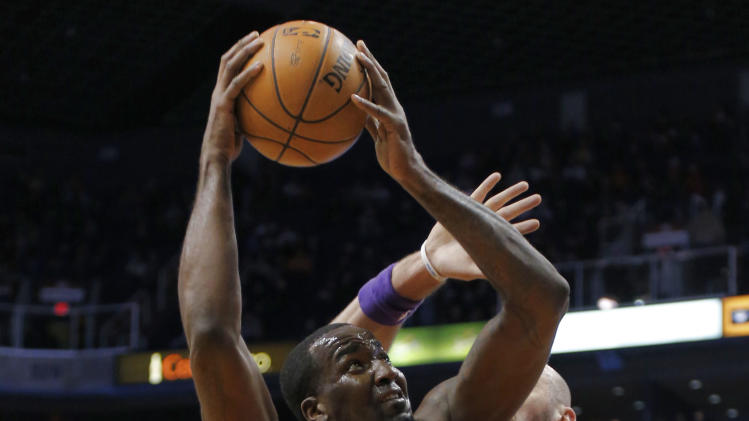 Oklahoma City Thunder center Kendrick Perkins (5) shoots over Phoenix Suns center Marcin Gortat, of Poland, during the first half of an NBA basketball game, Monday, Jan. 14, 2013, in Phoenix. (AP Photo/Matt York)