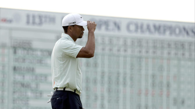 Tiger Woods reacts after putting on the 18th hole during the third round of the U.S. Open golf tournament at Merion Golf Club, Saturday, June 15, 2013, in Ardmore, Pa. (AP Photo/Charlie Riedel)