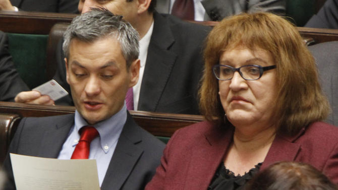 Robert Biedron, left, the first openly gay Polish lawmaker chats with Anna Grodzka, the first transsexual lawmaker, both from Palikot's Movement during the first session of the new Polish Parliament, in Warsaw, Poland, Tuesday, Nov. 8, 2011.  (AP Photo/Czarek Sokolowski)