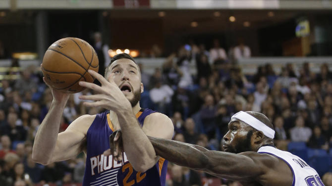 Phoenix Suns center Mile Plumlee, left, is fouled by Sacramento Kings forward Reggie Evans during the first quarter of an NBA basketball game in Sacramento, Calif., Friday, Dec. 26, 2014. (AP Photo/Rich Pedroncelli)